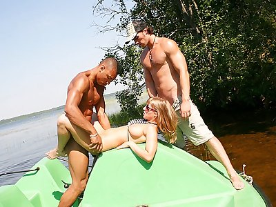 Jugged blond ravaged rigid in a boat